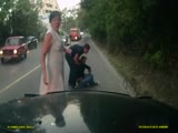 Woman falls asleep on scooter