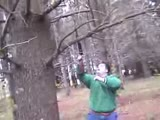 Kid hangs off tree branch snaps fail