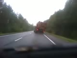 Truck loaded with logs close call
